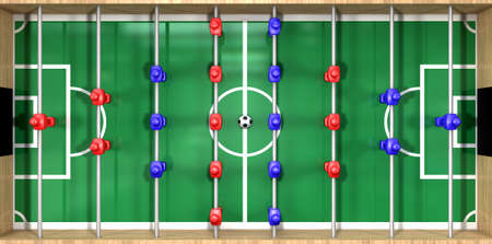 foosball: A direct top view of a wooden foosball table showing a blue and red team on a green marked pitch on an isolated white background