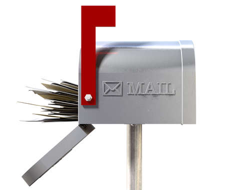 An side view of an old school retro tin mailbox with a red flag pointing upward showing that mail is present and an embossed mail envelope sign on an isolated background