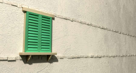 louvered: A regular wooden framed window with closed green shutters on an isolated plastered wall