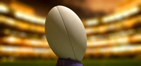 uprights: A plain white textured rugby ball on a blue kicking tee in a stadium at night