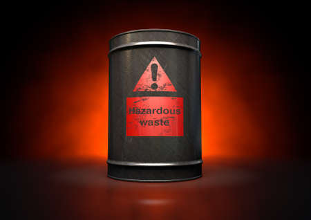 waste products: A black metal barrel with a red hazardous waste label
