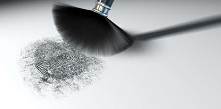 A crime scene brush dusting black talcum powder revealing and a fingerprint mark   photo
