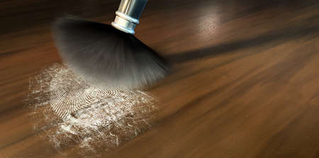dusting: A crime scene brush dusting black talcum powder revealing and a fingerprint mark on a wooden surface