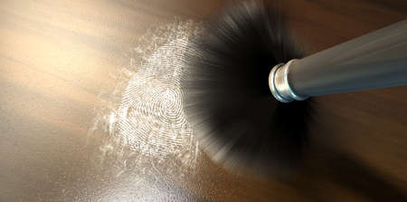 A crime scene brush dusting black talcum powder revealing and a fingerprint mark on a wooden surface photo