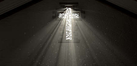 An interior building with a patterned stained glass window in the shape of a crucifix with a spotlight shining lights rays through it Stock Photo - 23380525