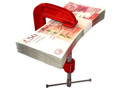 wads: A red clamp clamping down on a bundle of one hundred pound notes on an isolated studio background Stock Photo