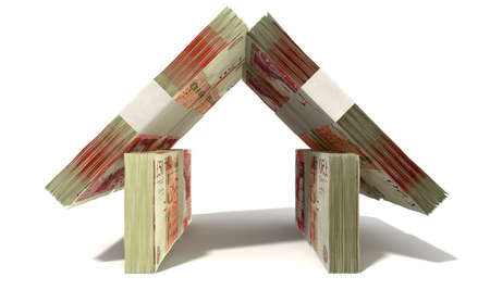 british money: Stacks of one hundred british pound bank notes assembled in the shape of a house on an isolated background Stock Photo