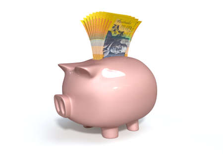 australian dollar notes: A pink ceramic piggy bank on an isolated white background with a wad of australian dollar notes stuffed into its slot