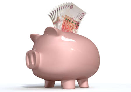 bank notes: A pink ceramic piggy bank on an isolated white background with a wad of british pound notes stuffed into its slot