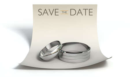 A marriage or engagement concept showing a man and womans silver wedding bands on a curled paper note with a heading saying save the date on an isolated white background