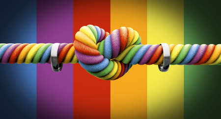 A coarse rope in the colors of the homosexual flag with a knot tied in the middle and two silver rings hanging on it on an isolated  photo