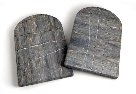 Two stone tabletsrepresenting the ten commandments on an isolated background  版權商用圖片