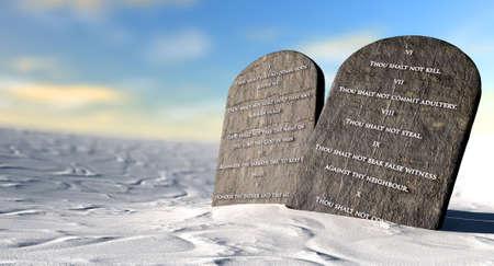 religion catolica: Dos tablas de piedra con los diez mandamientos inscritos en ellos de pie en la arena del desierto marr�n delante de un cielo azul Foto de archivo