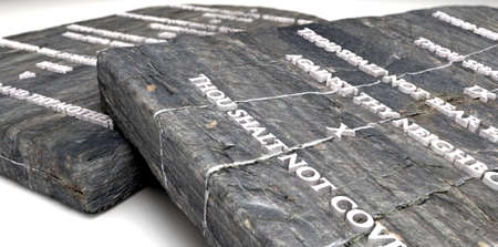 ten commandments: Two stone tablets with the ten commandments inscribed on them on an isolated background