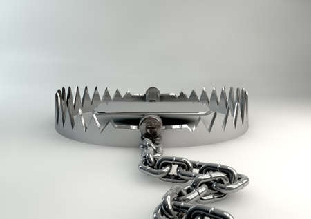 shackles: A metal animal trap that is open attached to the ground with a metal chain on an isolated studio background