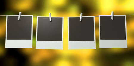 polaroids: A gallery of four blank polaroids pegged onto a string on a blurry abstract yellow background