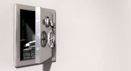 An open metal safe with bundles of us dollars on a light colored isolated wall background photo