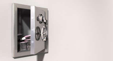 An open metal safe with bundles of european euros on a light colored isolated wall background photo