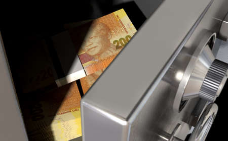 safety box: A sneak peak closeup of a slightly open metal safe revealing bundles of south african rands inside of it