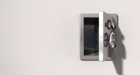 An empty metal safe on a light colored isolated wall background photo
