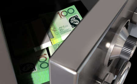 cash box: A sneak peak closeup of a slightly open metal safe revealing bundles of australian dollar notes inside of it Stock Photo