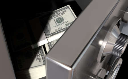 safety box: A sneak peak closeup of a slightly open metal safe revealing bundles of US dollar notes inside of it
