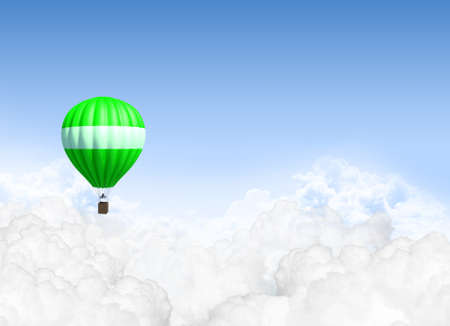A lonesome green hot air balloon floating above the clouds on a clear blue sky background photo