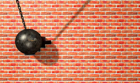 A regular metal wrecking ball attached to a chain hitting and breaking a face brick Stock Photo - 25173726