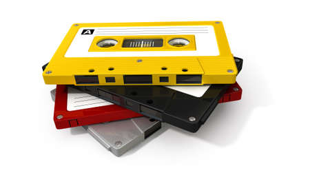 A close up view of a stack of four vintage audio cassette tapes with a labels on an isolated white background photo