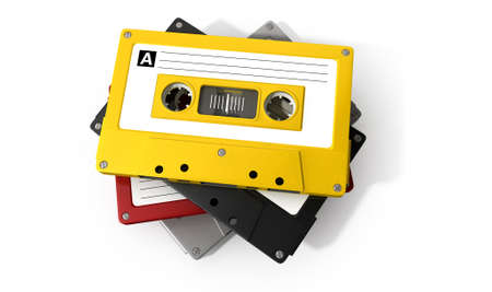 A close up view of a stack of four vintage audio cassette tapes with a labels on an isolated white background Stock Photo - 25251429