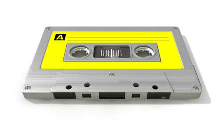A close up view of a grey vintage audio cassette tape with a yellow label on an isolated white background Stock Photo - 25251432