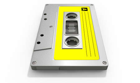 audio cassette: A close up view of a grey vintage audio cassette tape with a yellow label on an isolated white background
