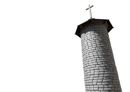 A plain stone tower turret with a wood and iron roof and a wooden crucifix on it on an isolated white background photo