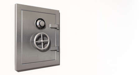safe money: A closed metal safe on a light colored isolated wall  Stock Photo