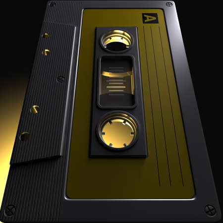 A dramatic close up view of a vintage audio cassette tape with a yellow label with a yellow backlit light photo