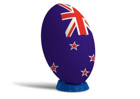 and rugby ball: Una pelota de rugby con textura en los colores de la nueva bandera nacional zelanda en un tee para patear sobre un fondo blanco aislado Foto de archivo