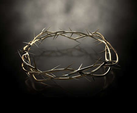 An upper view of a gold casting sculpture of branches of thorns woven into a crown depicting the crucifixion on a dark reflective surface spotlit by an eerie light photo