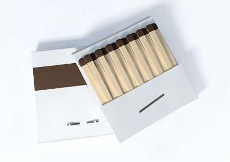 Two books of matches made with wood with blue tips in generic white unbranded cardboard books on an isolated background photo
