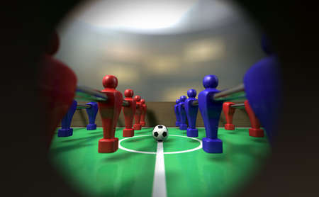 A view of a foosball team through a peephole in the side of the game showing them ready for kickoff photo