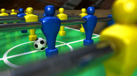 A foosball table at ground level with a soccer ball being competed for by a blue and yellow team ready to kick off a soccer match