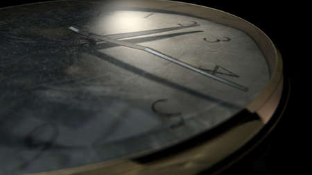 embellished: An extreme closeup of a section of a worn antique pocket watch on a dark sombre background Stock Photo