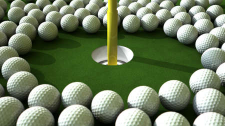 assail:  An array of balls ominously challenging a hole on the green Stock Photo