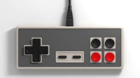 A regular vintage rectangular gaming controller with red and black buttons on an isolated white studio background Stock Photo