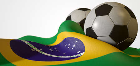 draped: A regular stitched panel soccer ball resting on a draped brazilian flag on an isolated white studio background