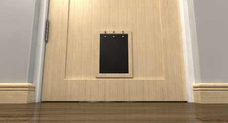 house trained: An inside view of a regular black pet flap on a light wood door surrounded  Stock Photo