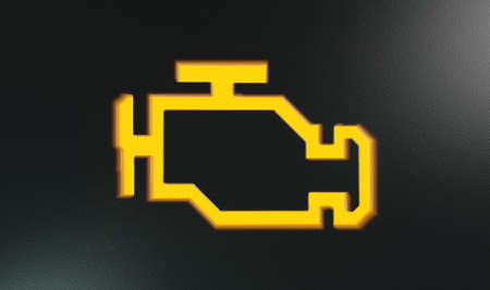 by light: An extreme closeup of an illuminated orange check engine indicator dashboard light on an isolated