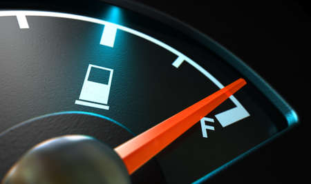 A closeup of a backlit illuminated gas gage with the needle indicating a near full tank