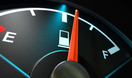 empty tank: A closeup of a backlit illuminated gas gage with the needle indicating a half full tank