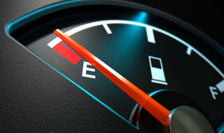 empty tank: A closeup of a backlit illuminated gas gage with the needle indicating an empty tank on an isolated
