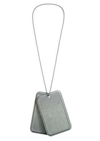 A regular set of blank military dog tag identity tags attached to a chain hanging on an isolated background photo